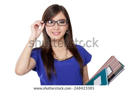 Beautiful Asian librarian lady smiling while holding her glasses and some books, on white background - stock photo