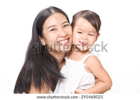 Beautiful Asian Mother and Adorable Baby Girl Hugging with Love and Happiness. - stock photo