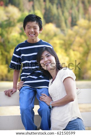 Beautiful Asian Mother and Her son portrait - stock photo