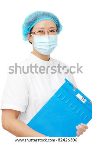 beautiful Asian nurse with medical record folder - stock photo