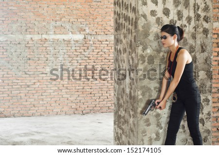 Beautiful Asian policewoman in action. - stock photo