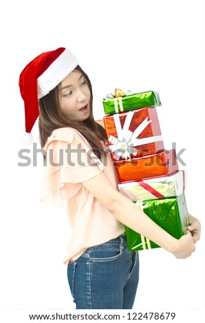 Beautiful Asian santa woman showing gift.