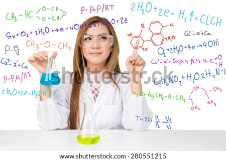 Beautiful Asian scientific researcher holding a liquid solution with science or chemistry formula on white background - stock photo