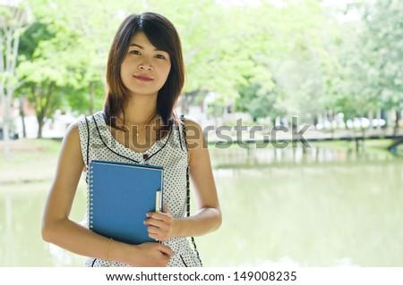 Beautiful Asian student woman portrait. - stock photo