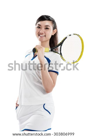 Beautiful Asian tennis player smiling and looking at the camera