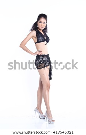 Beautiful Asian Thai Model Female in Fashion Black Sport Swim Suit Fashion Make Up with Accessory on White Background in Studio Lighting, isolated, stand full body