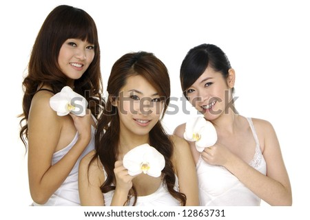 Beautiful Asian woman and  orchid - stock photo