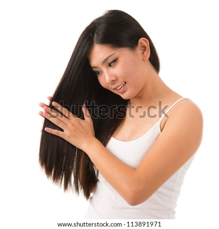 Beautiful Asian woman applying hair cream, isolated on white background