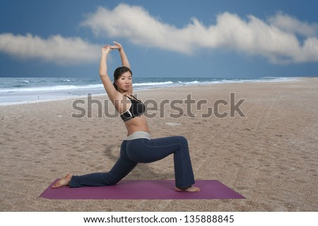 Beautiful Asian woman doing her Yoga exercises