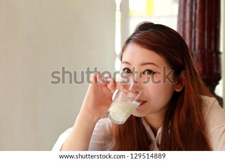 Beautiful asian woman drink a milk - stock photo