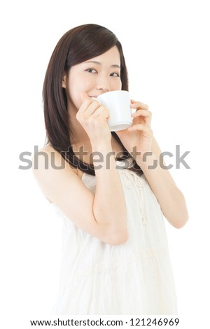 Beautiful asian woman drinking coffee on white background