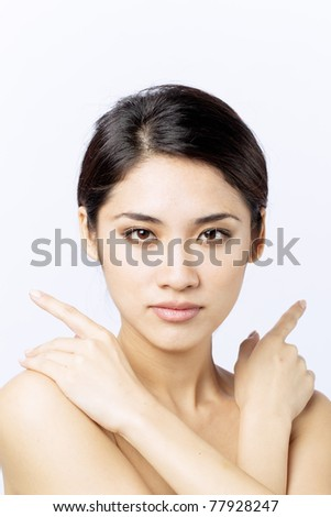 Beautiful Asian woman framing her face with hands. - stock photo