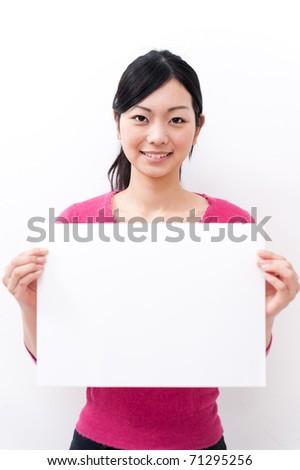 beautiful asian woman holding a blank whiteboard - stock photo