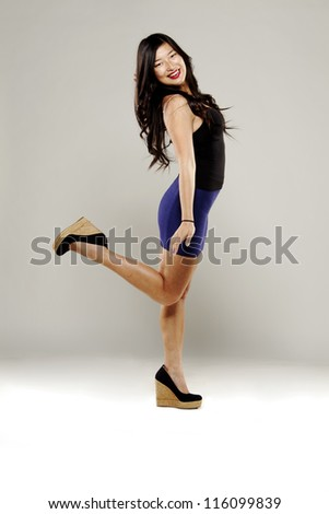 Beautiful asian woman in fancy dress serious face for camera - stock photo
