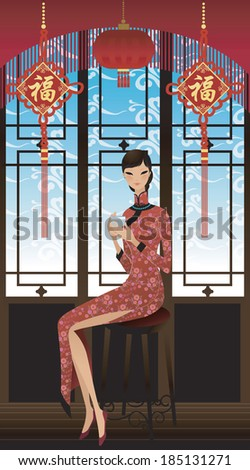Beautiful Asian woman in traditional Chinese dress and drinking tea - stock photo