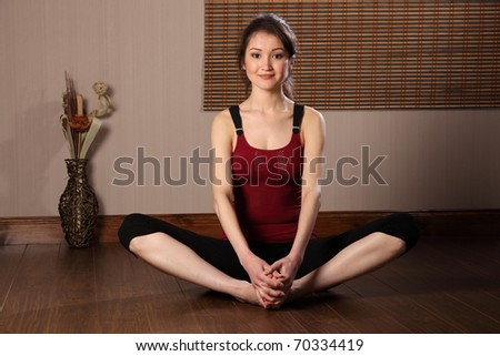 Beautiful asian woman in warm up stretch exercise - stock photo