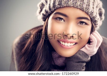 Beautiful Asian woman in warm winter clothes. - stock photo