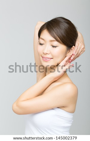 Beautiful asian woman isolated on gray background
