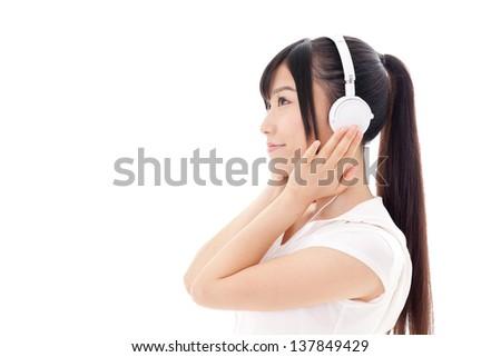 beautiful asian woman listening music on white background - stock photo