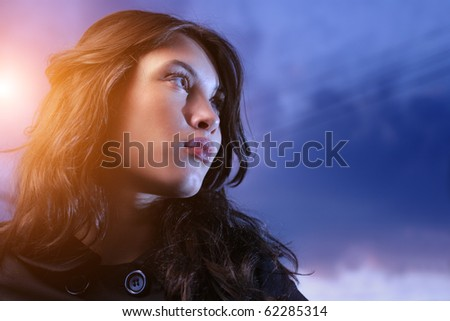Beautiful asian woman looking up at twilight - stock photo