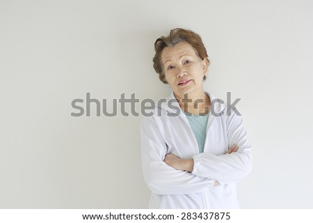 Beautiful Asian woman of the elderly are confident arm in arm - stock photo