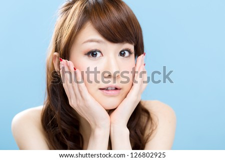 Beautiful asian woman on blue background - stock photo