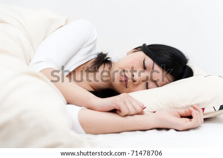 beautiful asian woman on the bed - stock photo
