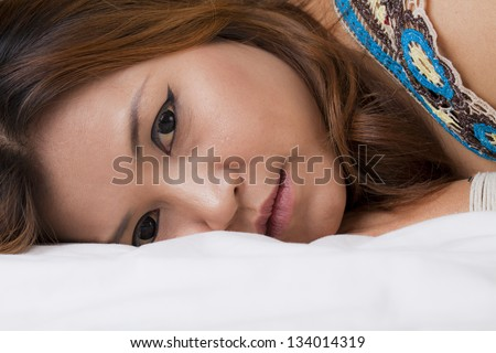 beautiful asian woman on the bed ,close-up face.