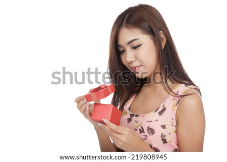 Beautiful Asian woman open a  red gift box  isolated on white background