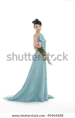 beautiful asian woman poses in her gown - stock photo