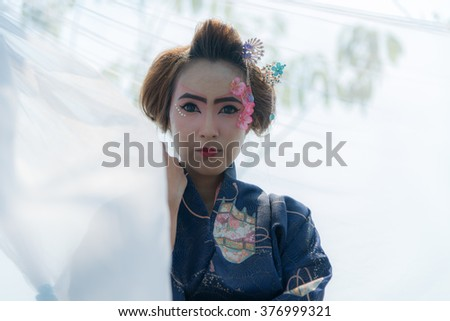 Beautiful asian woman's portrait, geisha in kimono - stock photo