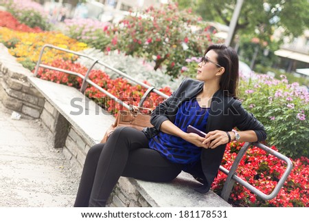 Beautiful Asian Woman Sitting and Relaxing on Chair in Summer  - stock photo