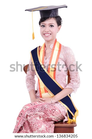 beautiful asian woman sitting happy since his graduation, isolated on white background - stock photo