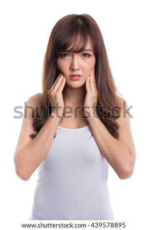Beautiful asian woman suffering from toothache on white background