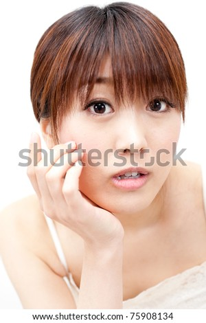 beautiful asian woman taking care of her eye
