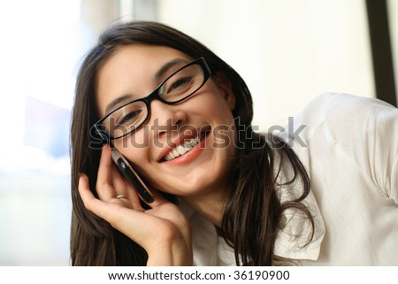 Beautiful asian woman talking on cell phone