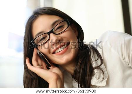 Beautiful asian woman talking on cell phone - stock photo