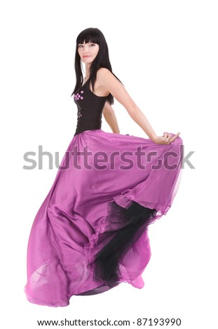 Beautiful asian woman twirling in her fashionable purple color dress - stock photo