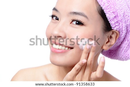 Beautiful asian woman washing her beauty face with cleansing foam on her hands, isolated on white background - stock photo