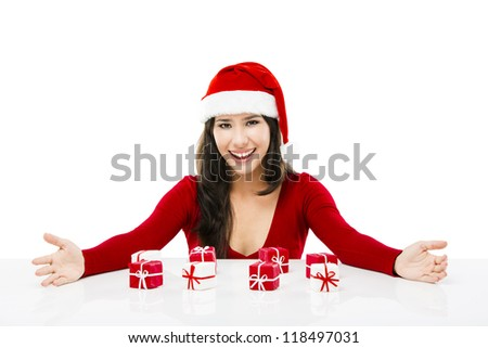 Beautiful asian woman wearing Santa's hat with small christmas gifts, isolated on white