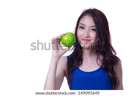 Beautiful Asian woman with a green apple