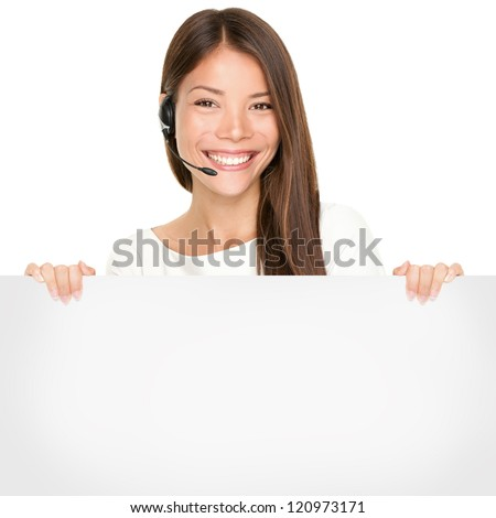Beautiful Asian woman with a lovely smile wearing a headset and microphone holding a blank white sign in her hands for your advertising or text isolated on white - stock photo