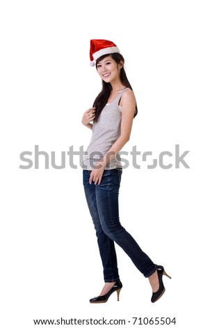 Beautiful Asian woman with Christmas hat, full length portrait isolated over white. - stock photo
