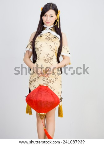 beautiful Asian woman with gesture of congratulation lantern happy chinese new year - stock photo