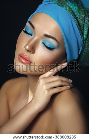 Beautiful asian woman with hijab. Etnic beauty portrait. Perfect clean skin. Blue bright make up. - stock photo