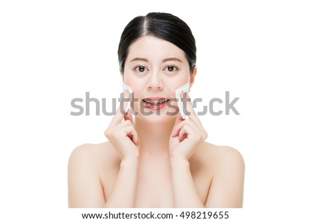 Beautiful asian woman with pure healthy skin and remove makeup from face with cotton swab. asian beauty concept. isolated on white background