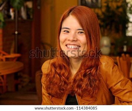 Beautiful Asian Woman with Red Hair - stock photo