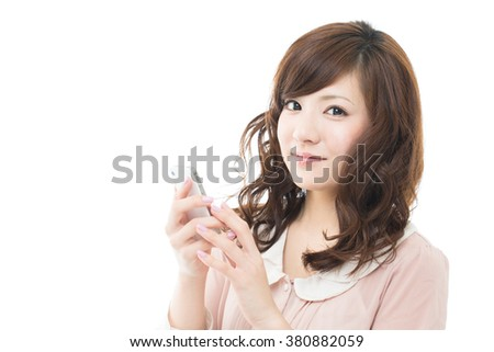Beautiful asian woman with the cell phone - stock photo
