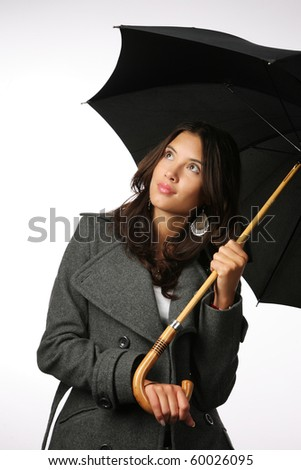 Beautiful Asian woman with umbrella against white background