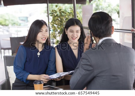 Beautiful asian woman working with team for outdoor business discussion, business discussion concept. 20-28 year old.